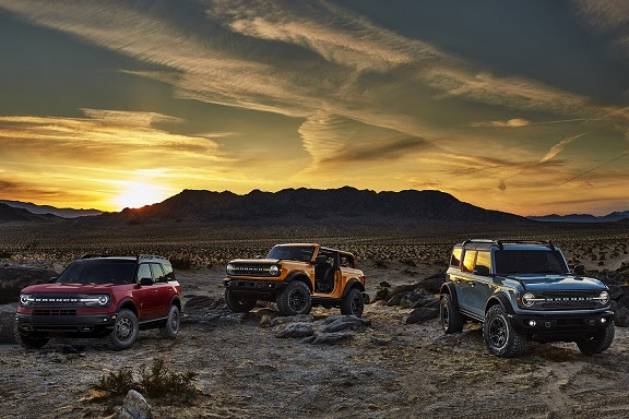 3 bronco vehicles in the sunset